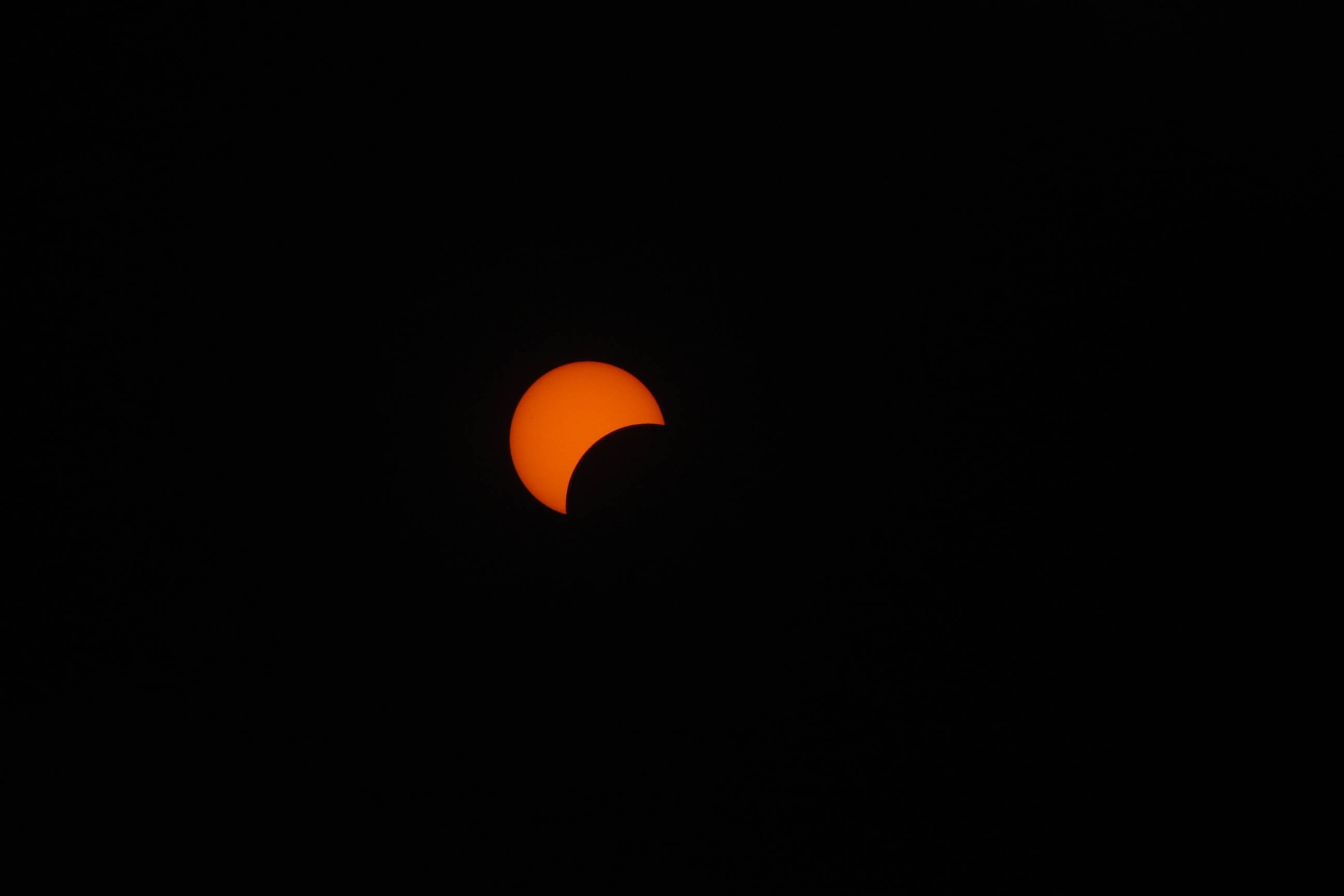 The moon starting to eclipse