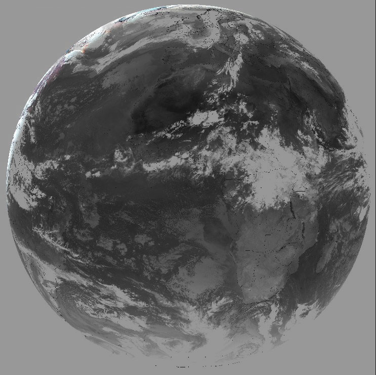 Meteosat-10 channel 10.8 µm completed with the natural solar composite in the upper boundary, 20 June 22:42 UTC