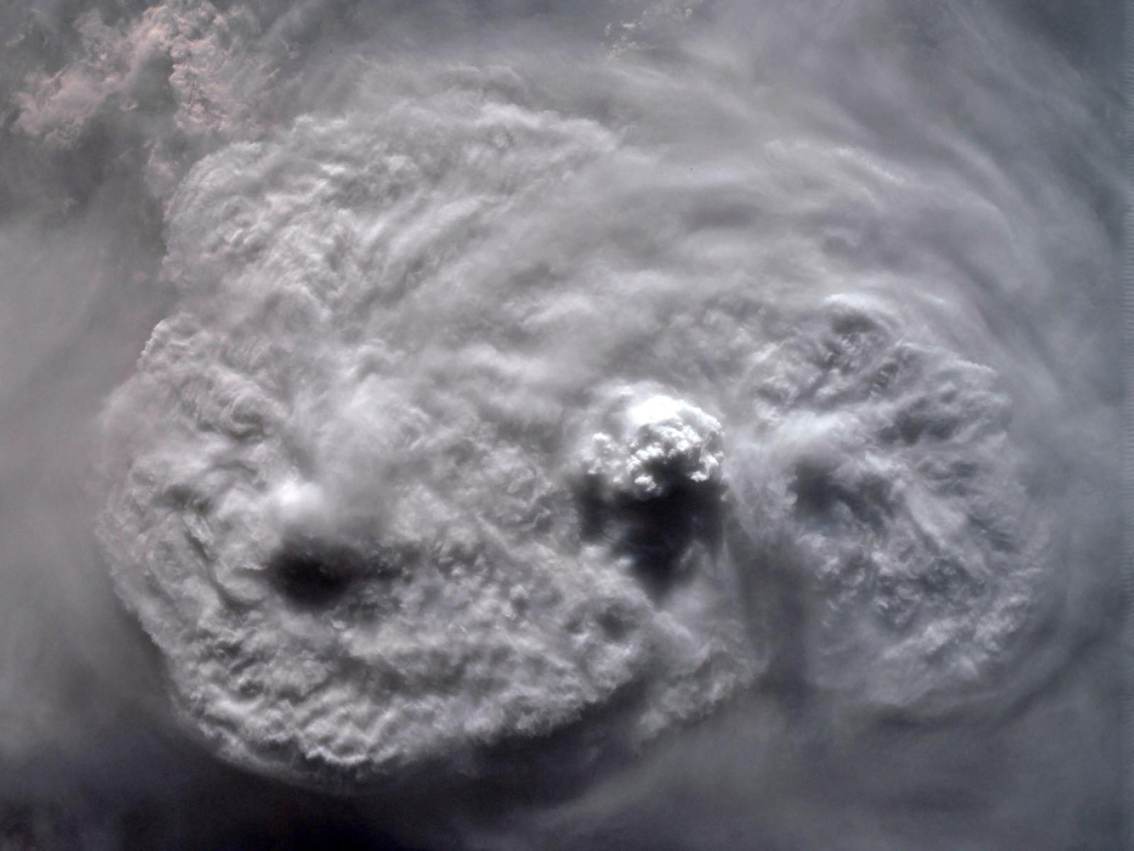 Storm with overshooting top, jumping cirrus, plume, and a 'pancake cloud'. Credit: NASA