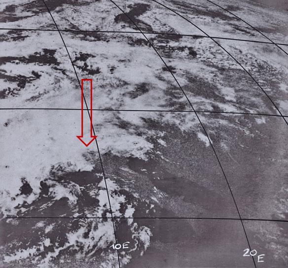 Meteosat-1 Visible image, 7 August 12:00 UTC. Arrow marks point of interest.