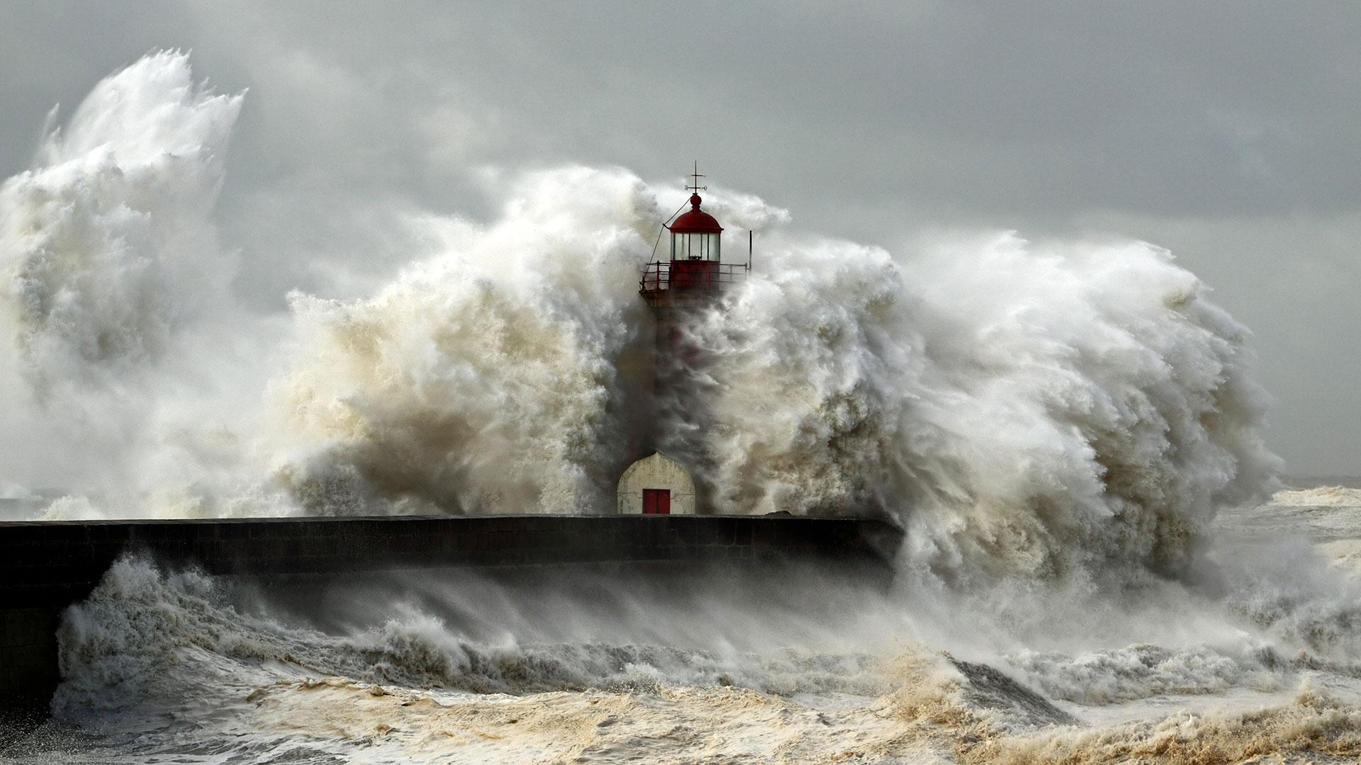 Waves breaking on sea wall