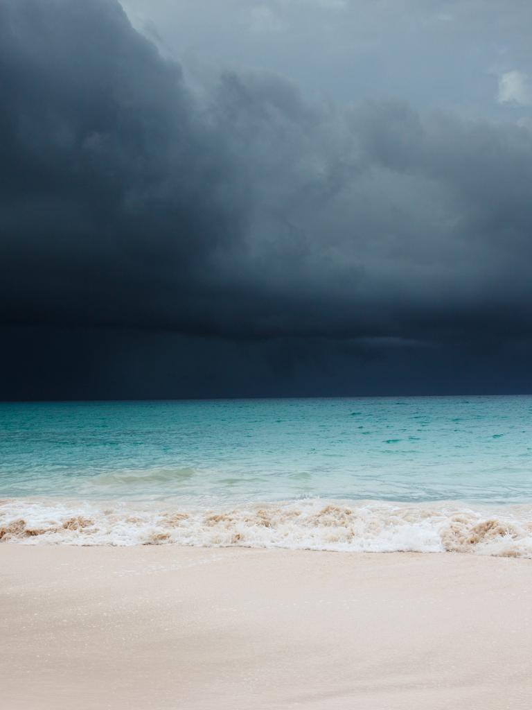 Storm clouds over a tropical beach